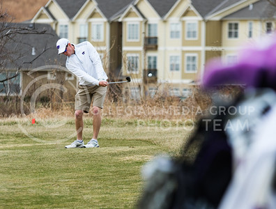 Senior Jack Rickabaugh, K-State Men's Golf player, practices chipping at Colbert Hills Golf Course on Mar. 9, 2017. (John Benfer | Royal Purple)