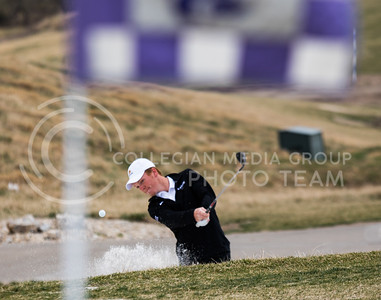 Freshman Jacob Eklund, K-State Men's Golf player, practices hitting balls out of a sand trap at Colbert Hills Golf Course on Mar. 9, 2017. (John Benfer | Royal Purple)