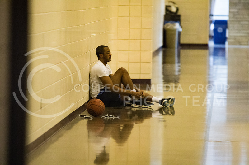 Junior in marketing, Isiah Daniels laces his shoe while sitting in the K-State Recreational Center on Jan. 3, 2017. (John Benfer | Royal Purple)