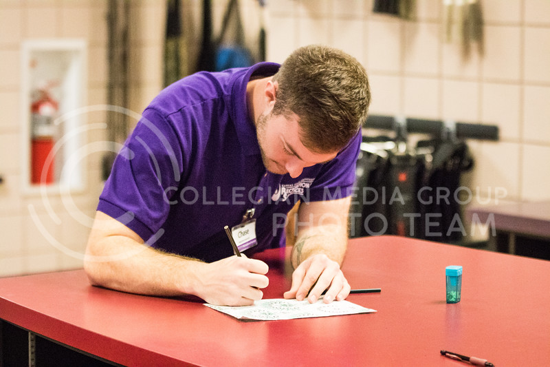 Senior in kinesiology, Chase Hart draws while working in the K-State Recreational Center on Jan. 3, 2017. (John Benfer | Royal Purple)