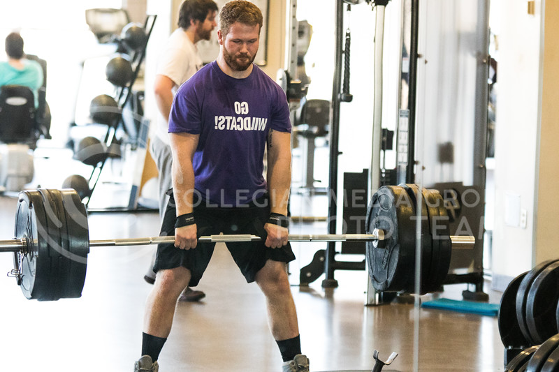 Junior in mechanical engineering, August Dunlop lifts weights in the K-State Recreational Center on Jan. 3, 2017. (John Benfer | Royal Purple)