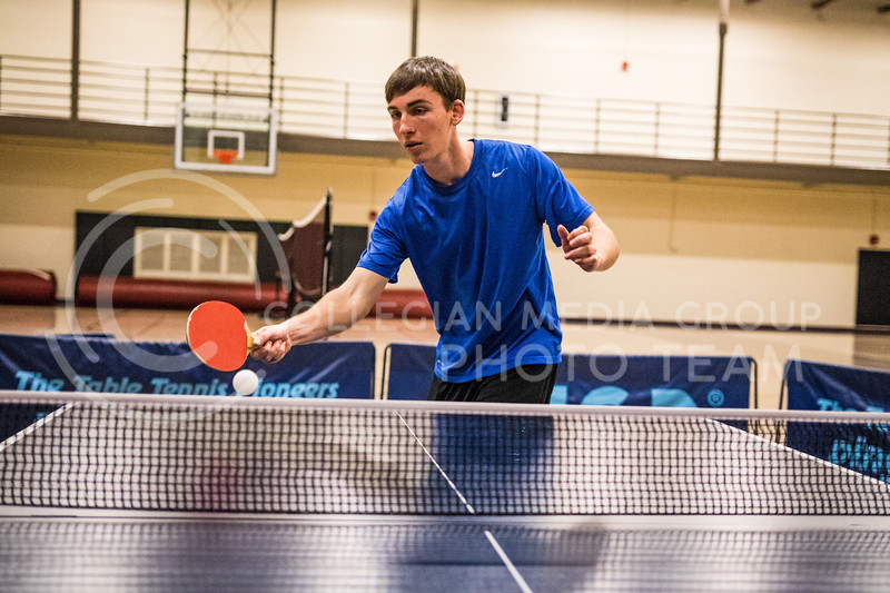 Freshman in industrial engineering, Bryan Armbrust serves a ping-pong ball in the K-State Recreational Center on Jan. 3, 2017. (John Benfer | Royal Purple)