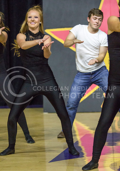 Members in the Greek pairing of Chi Omega, Delta Upsilon and Alpha Omega Epsilon perform a dance routine during Wildcat Request Live at Bramlage Coliseum on Oct. 17, 2017. (Sabrina Cline | Collegian Media Group)