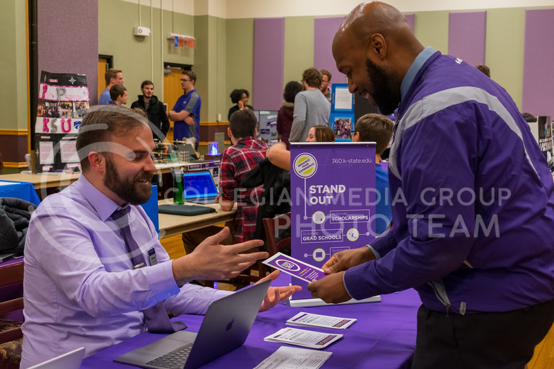 Program coordinator, Trent McGee (left), discussing the features of the new K-State 360 tool at the Wildcat Winter Expo in the Union Ballroom on January 18, 2018. (Alex Todd | Collegian Media Group)