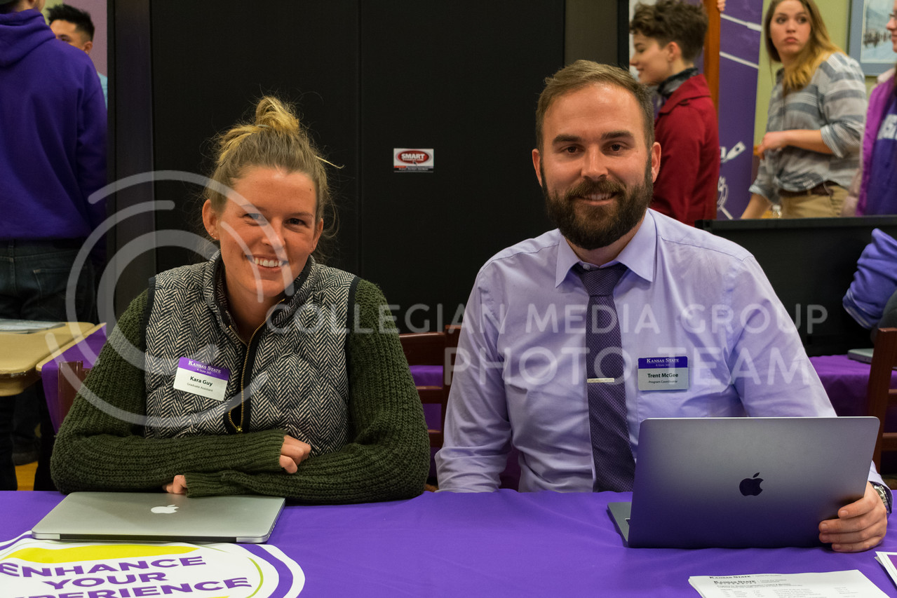 Graduate assistant, Kara Guy (left), and program coordinator, Trent McGee (right), at the K-State 360 booth during the Wildcat Winter Expo in the Union Ballroom on January 18, 2018. (Alex Todd | Collegian Media Group)