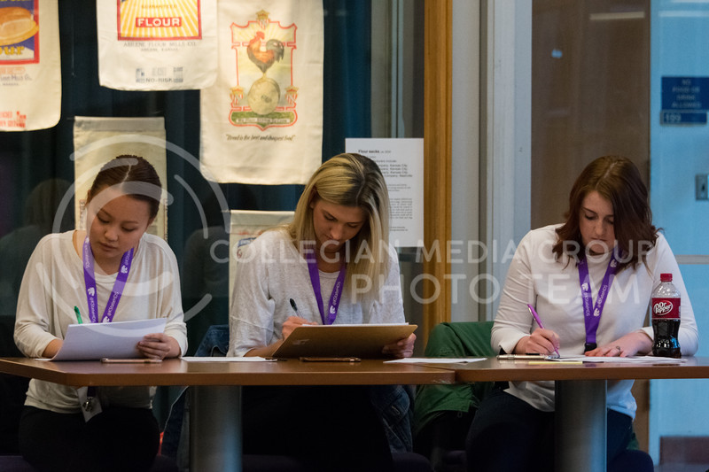 The judges write down scores for each model at the ATID model casting call in Justin Hall on March 1, 2018. (Alex Todd | Collegian Media Group)