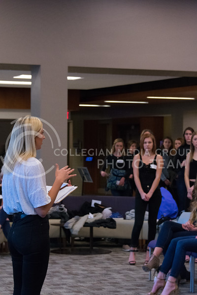 Abby Pfannenstiel, sophomore in apparel and textiles, welcomes models to the ATID model casting call in Justin Hall on March 1, 2018. (Alex Todd | Collegian Media Group)