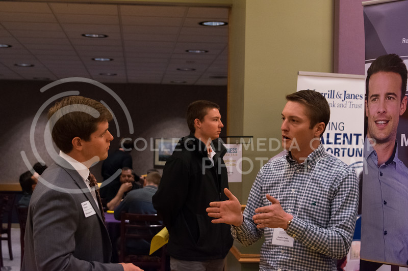 Senior in management, Lawson Roberts learns more about Penske at the business career fair in the union ballroom on February 21, 2018. (Alex Todd | Collegian Media Group)