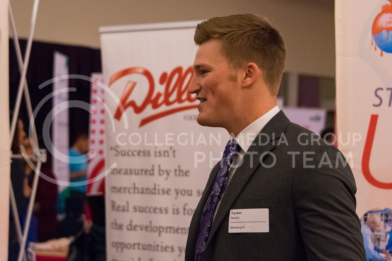 Senior in marketing, Tucker Sweely, talks about some of his work experience during the business career fair in the union ballroom on February 21, 2018. (Alex Todd | Collegian Media Group)