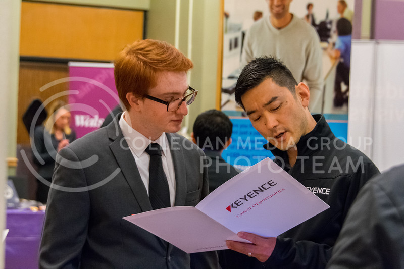 Nicholas Crippen, senior in finance, discuesses potential career opportunities with Keyence at the College of Business career fair on February 21, 2018 in the union ballroom. (Alex Todd | Collegian Media Group)