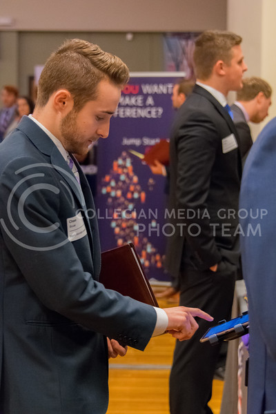 Senior Chase Bouse fills out an online information form before speaking with a Pepsico representative at the business career fair on Feburary 21, 2018 in the union ballroom. (Alex Todd | Collegian Media Group)