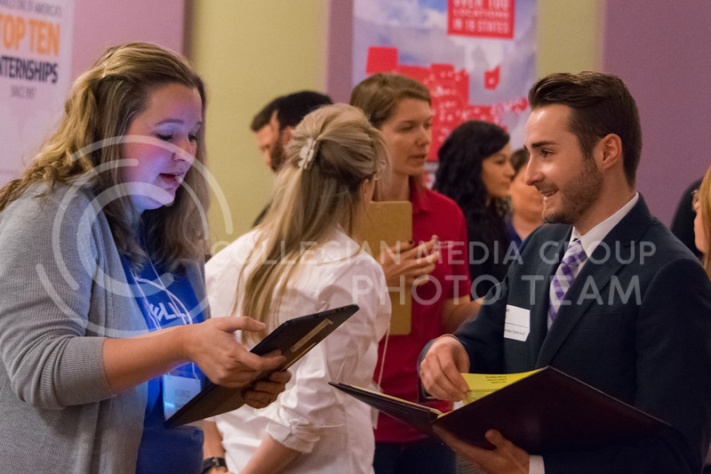 Hundreds of students and employers talked about job opportunities at the College of Business career fair in the union ballroom on February 21, 2018. (Alex Todd | Collegian Media Group)