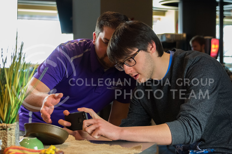 Senior in Computer Science, Eli Seigel, learns the basics of food photography from the K-State Housing and Dining Communications and Marketing Project Coordinator, Alex Abendschein. The workshop was part of the monthly Housing and Dining Cultivate You at Kramer Dining Center on February 21, 2018. (Alex Todd | Collegian Media Group)