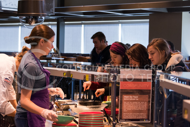 Students line up to get a bowl of healthy food at Cultivate You in the Kramer Dining Center on February 21, 2018. (Alex Todd | Collegian Media Group)
