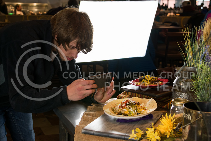 Jordan Bezdek, Architecture graduate student, snaps a photo of his delicious looking burrito at Kramer Dining Center on February 21, 2018. (Alex Todd | Collegian Media Group)