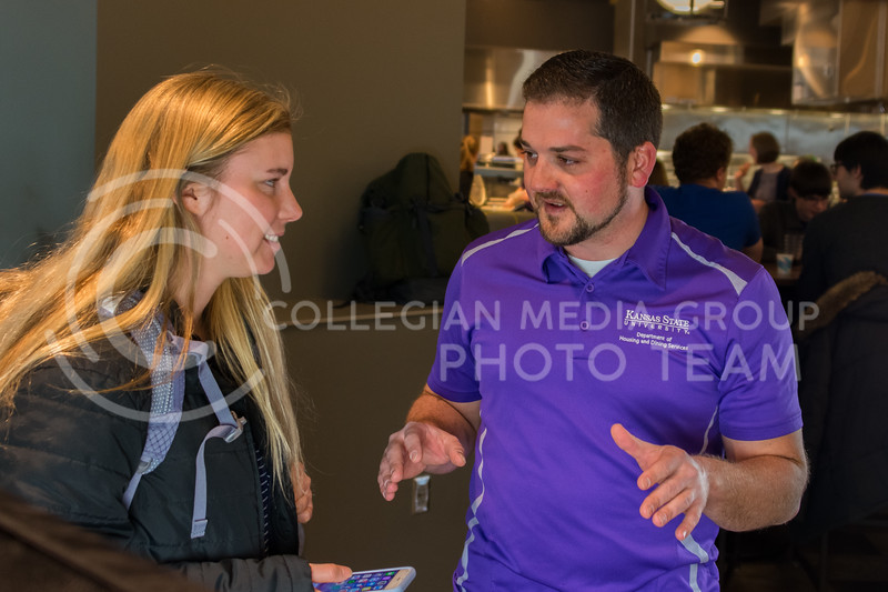 """K-State Housing and Dining Communications and Marketing Project Coordinator Alex Abendschein, gives students tips on food photography at Kramer Dining Center for """"Cultivate You"""" on February 21, 2018. (Alex Todd 
