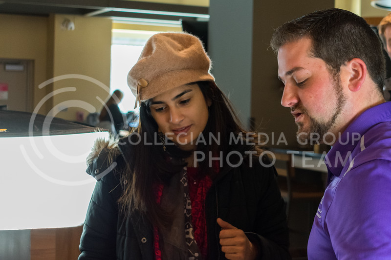 Eunice Varona, senior in Industrial Engineering, learns about the basics of food photography at the K-State Housing and Dining Cultivate You event on February 21, 2018. (Alex Todd | Collegian Media Group)