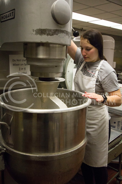 A cook checks the mixing tub in the bakery department at the Derby Dining Center on March 2, 2018. ( Sabrina Cline | Collegian Media Group)