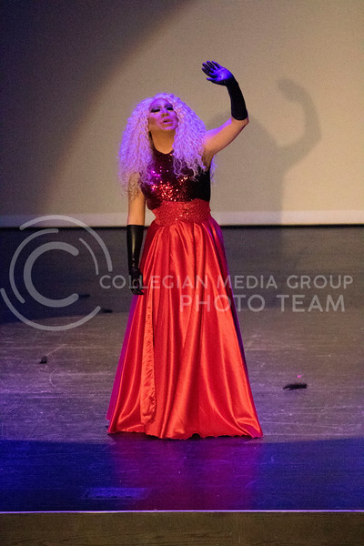 Slowing her performance down, Queen Lil' Kim Chi sings a slower song during the Drag Show at McCain Auditorium on Feb. 9, 2018.  Sabrina Cline | Collegian Media Group
