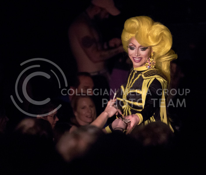 In a new outfit, Queen Victoria Fox comes into the audience to collect tips and continue her performance during the Drag Show at McCain Auditorium on Feb. 9, 2018.  Sabrina Cline | Collegian Media Group
