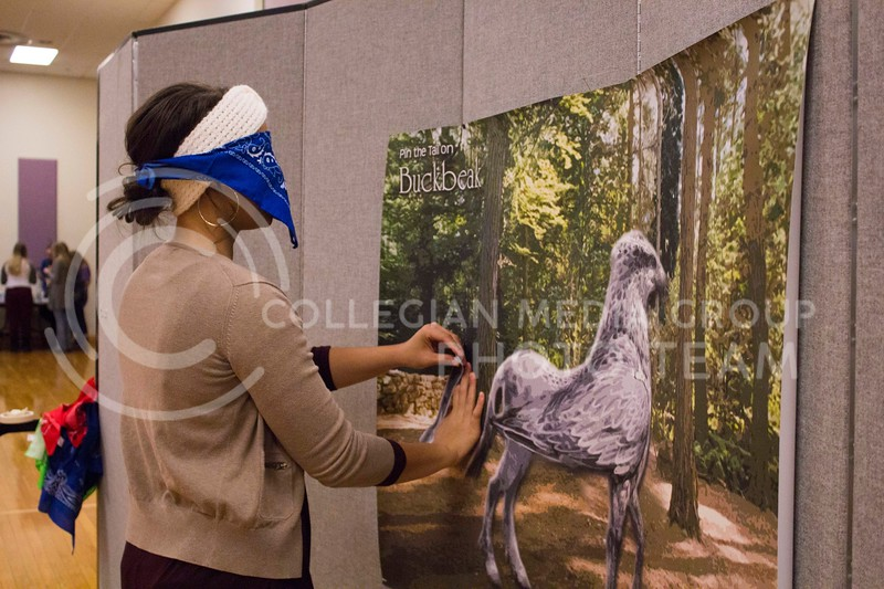 Janeigh Dantzon, senior in secondary education, pins the tail on Buckbeak during the Harry Potter Dessert Theater held at the K-State Student Union on Nov. 10, 2017. (Maddie Domnick | Collegian Media Group)