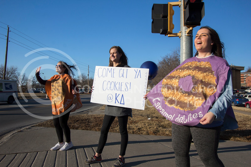 Members of Kappa Delta Sorority stand at the corner of Claflin Rd. and Manhattan Ave. to direct oncoming cars to the Kappa Delta Chapter House to help support the Girl Scouts sell cookies on Feb. 13, 2017 Sabrina Cline | Collegian Media Group