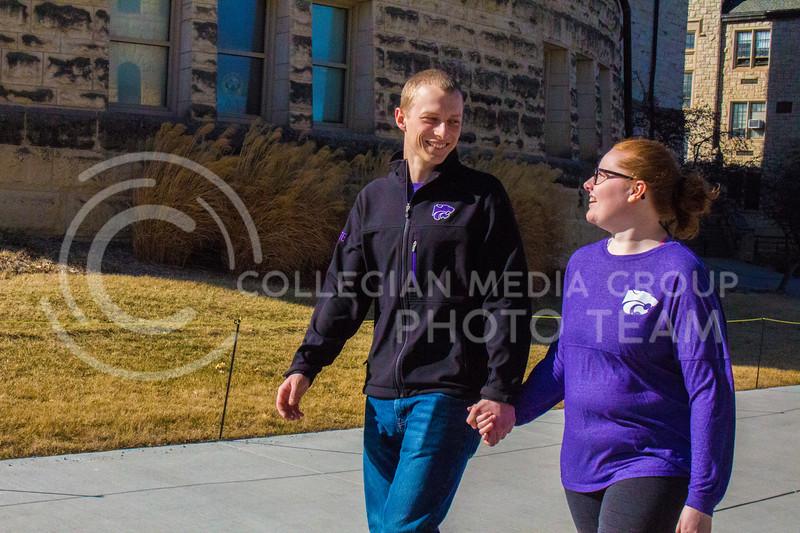Senior Landon Becker takes a walk around campus with Fiancee Senior Emily Czepiel. ( Dalton Wainscott )