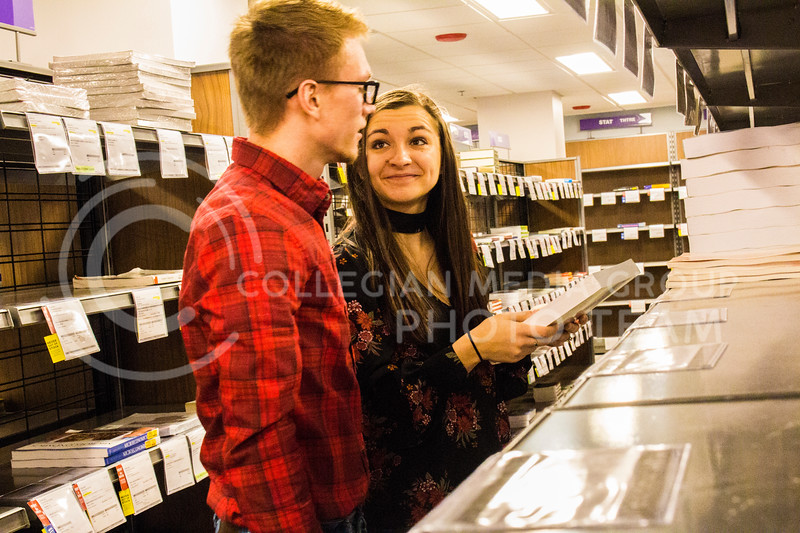 Senior Kristen Egger and her husband Graduate Corey Egger look at texbooks in the Union Bookstore. ( Dalton Wainscott )