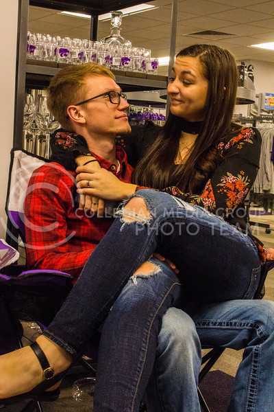 Senior Kristen Egger and her husband Graduate Corey Egger get comfy in a folding chair in the Union. ( Dalton Wainscott )