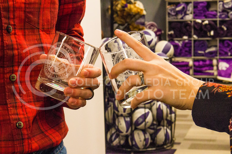Senior Kristen Egger and her husband Graduate Corey Egger raise a toast in the Union Bookstore. Kristen makes sure to show off her wedding ring.         ( Dalton Wainscott )