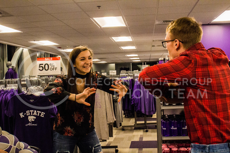 Senior Kristen Egger gets ready to catch a pass from her husband Graduate Corey Egger in the Union Bookstore. Corey makes a funny face to try and distract Kristen. ( Dalton Wainscott )