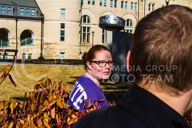 Senior Emily Czepiel looks over her shoulder at fiance Senior Landon Becker near Hale Library. ( Dalton Wainscott )
