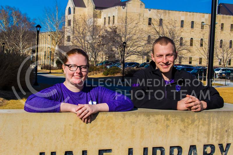 Senior Landon Becker poses with Fiancee Senior Emily Czepiel next to the sign for Hale library. ( Dalton Wainscott )