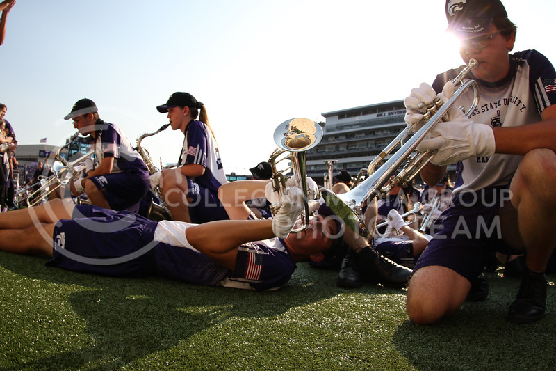 Steven Schmoll lays on the ground and plays trumpet prior to the Kansas State University vs University of Central Arkansas football game (Photo by Cooper Kinley | Kansas State Athletics)