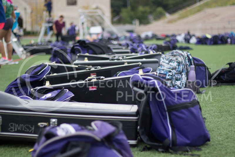 Intrument gear and bags are lined up on the side while the band players are at practice at Memorial Stadium on October 3rd, 2017. (Kelly Pham | Royal Purple)
