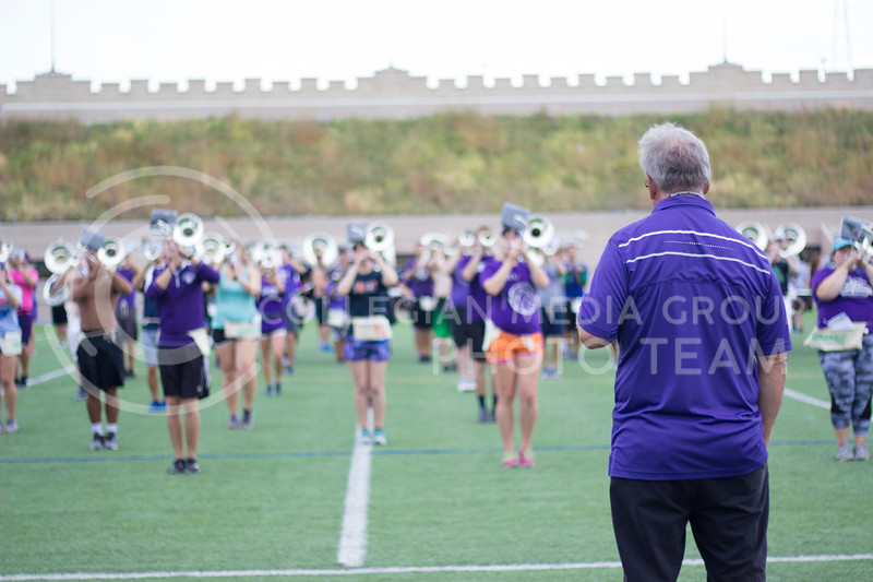 Band director Frank Tracz observes and critiques the band at practice at Memorial Stadium on October 3rd, 2017. (Kelly Pham | Royal Purple)