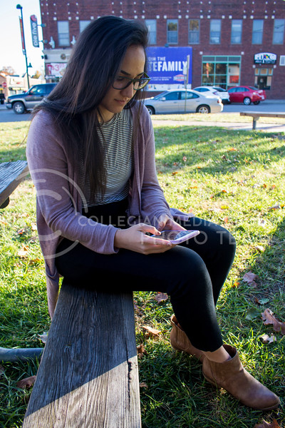 Christina DeGraffenreid, senior in speech pathology and gerontology, checks her phone on Nov. 8, 2017. (Abby Cambiano | Collegian Media Group)