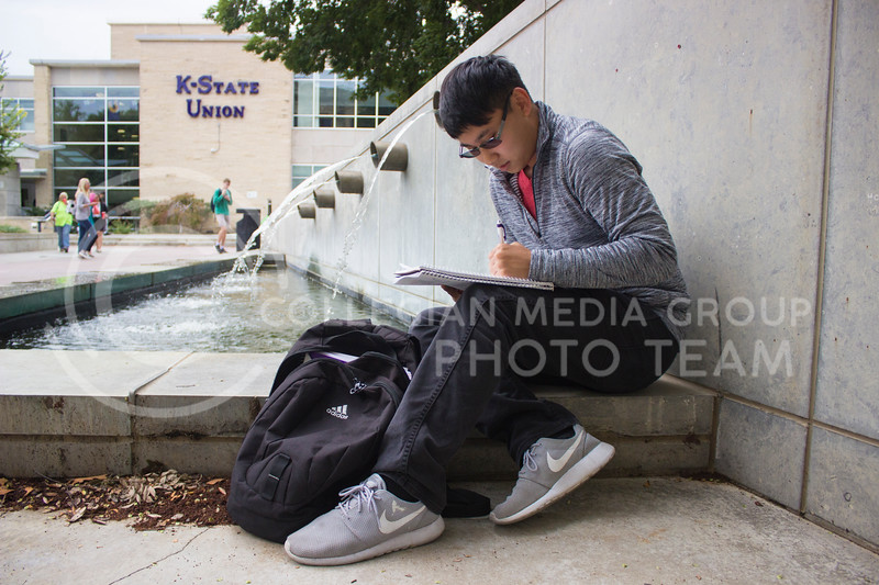 Junior in mechanical engineering Shane Lee takes time to study outside of the Union on September 28th, 2017. (Kelly Pham | Royal Purple)