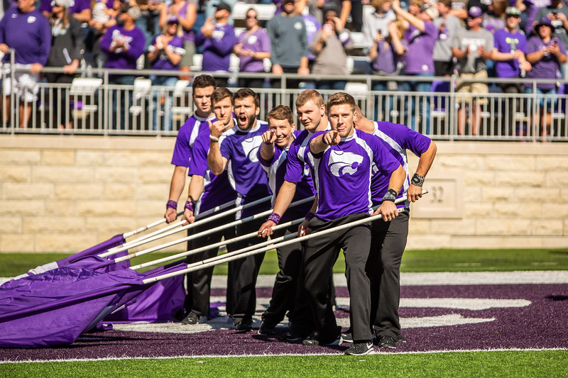 K-State yell leaders prepare to run out on the field before the football game against TCU at Bill Snyder Family Stadium on Oct. 19, 2019. The Wildcats took the Horned Frogs 24-17. (Logan Wassall | Collegian Media Group)