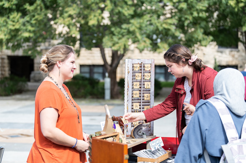 Meg Shearer, a junior in mass communications, browses through a collection of jewelry at the Kansas State Farmers' Market in Bosco Student Plaza on September 26, 2018. (Alex Todd | Collegian Media Group)