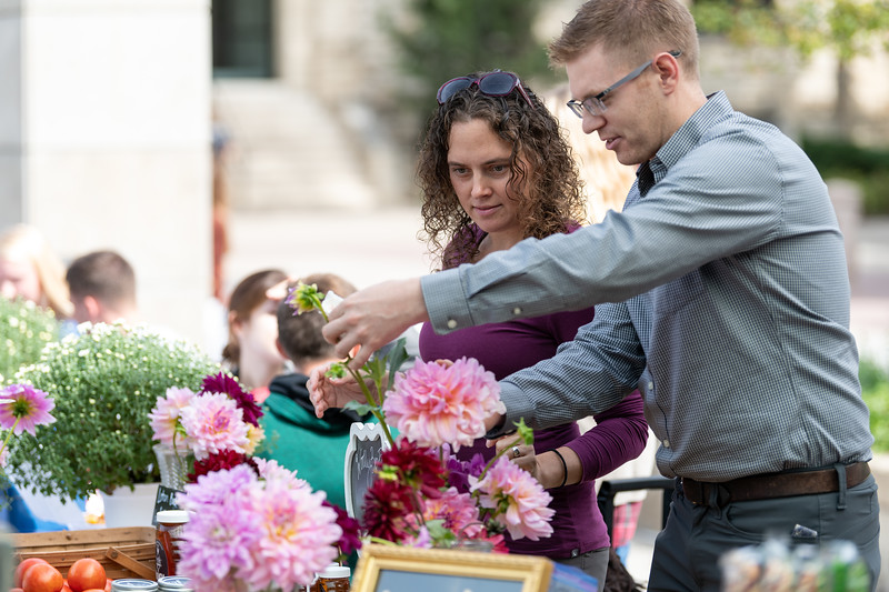 Several K-State students and faculty setup booths outside the union on September 26, 2018 for the Kansas State Farmers' Market. (Alex Todd | Collegian Media Group)