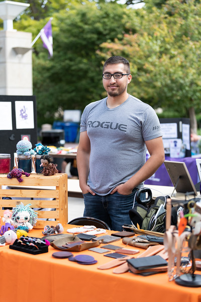 Victor Andrews, a graduate student in Public Health and co-owner of Soft Kitty Kreations and Acscendent Gear, sells goods at the Kansas State Farmers' Market in Bosco Student Plaza on September 26, 2018. (Alex Todd | Collegian Media Group)