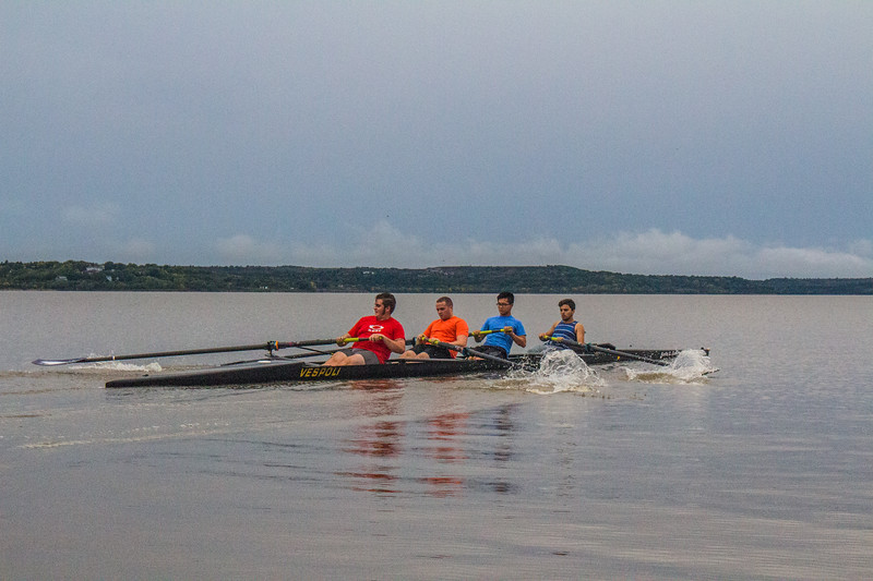 "Sophomore Noah Guinn followed by Freshmen Brady Walls, Graduate student James Lin and Freshmen Anthony Suitt rowing at ""race pace"". Noah, Brady and Anthony make a huge splash coming of the recovery. ( Dalton Wainscott I Collegian Media Group )"