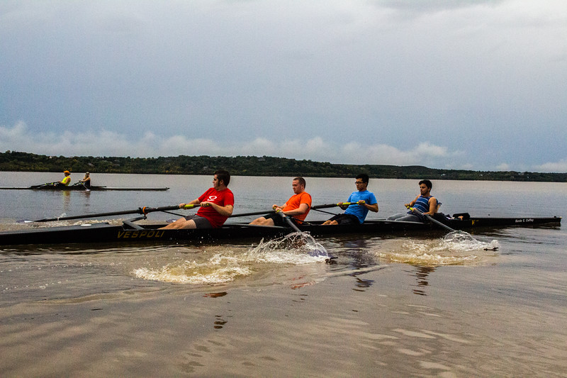 "Sophomore Noah Guinn followed by Freshmen Brady Walls, Graduate student James Lin and Freshmen Anthony Suitt rowing at ""race pace"" along the far side of tuttle creek in the Men's Four. John Wendt and Freshmen Calli Pirner run parallel in the Double. ( Dalton Wainscott I Collegian Media Group )"