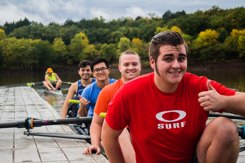 Sophomore Noah Guinn followed by Freshmen Brady Walls, Graduate student James Lin and Freshmen Anthony Suitt pose for a picture before launching the Men's Four. ( Dalton Wainscott I Collegian Media Group )