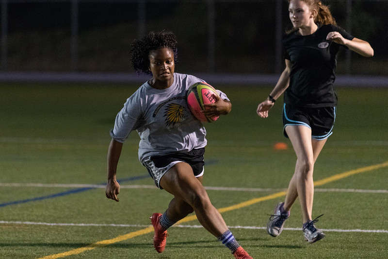 K-State freshman Martay Vanwey grabs ahold of the ball and carries it down the field during rugby practice at Memorial Stadium on September 20, 2018. (Alex Todd | Collegian Media Group)