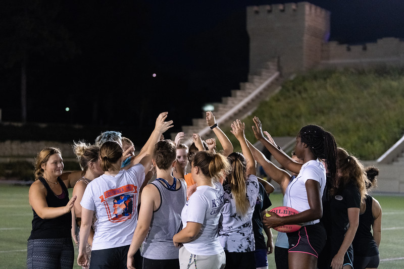 The K-State women's rugby team finishes up practice on September 20, 2018 with a group huddle. (Alex Todd | Collegian Media Group)