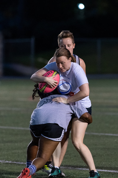 Assistant coach Lauren Chlebanowski gets tackled during practice at Memorial Stadium on September 20, 2018. (Alex Todd | Collegian Media Group)