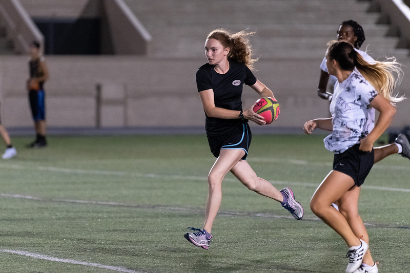 K-State senior Brigid Murphy runs down the field with the ball during rugby practice at Memorial Stadium on September 20, 2018. (Alex Todd | Collegian Media Group)