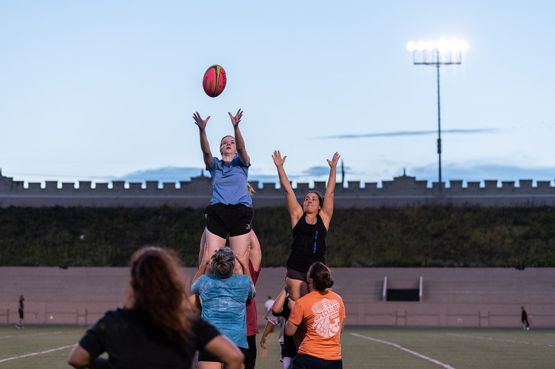 K-State sophomore Anna Porting and sophomore Patti Noriega are lifted up into the air for a lineout during practice on September 20, 2018 in Memorial Stadium. (Alex Todd | Collegian Media Group)